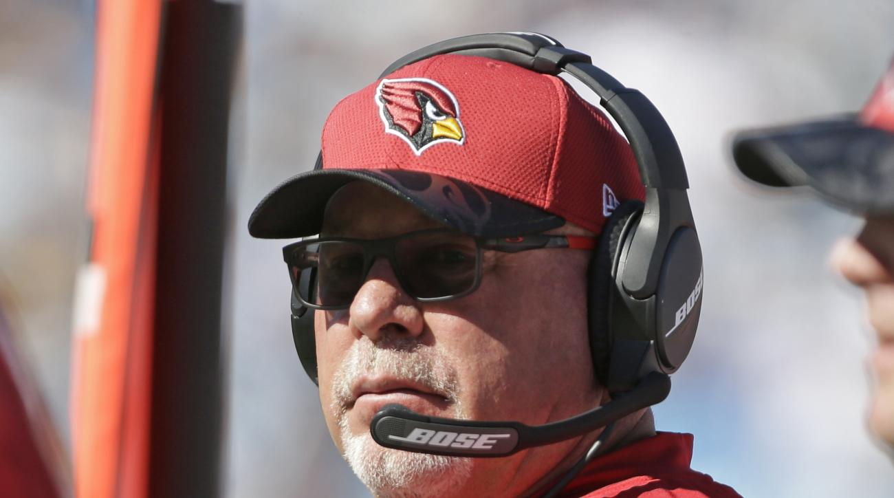 FILE - In this Oct. 30, 2016, file photo, Arizona Cardinals head coach Bruce Arians watches the action in the first half of an NFL football game against the Carolina Panthers in Charlotte, N.C. Halfway through their season, the Cardinals are one of the le