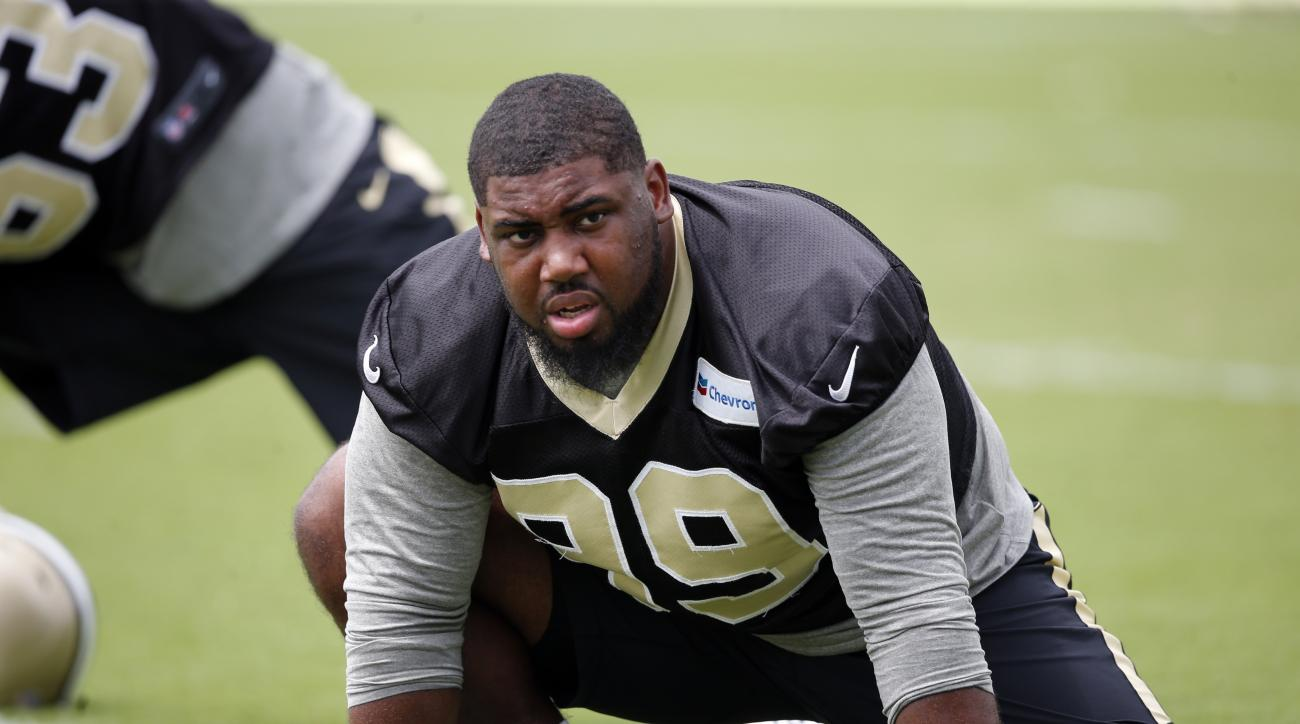 FILE - In this June 14, 2016, file photo, New Orleans Saints defensive tackle Sheldon Rankins (99) stretches during the NFL football team's minicamp in Metairie, La. Saints coach Sean Payton sounds optimistic that Rankins will make his NFL debut in San Fr