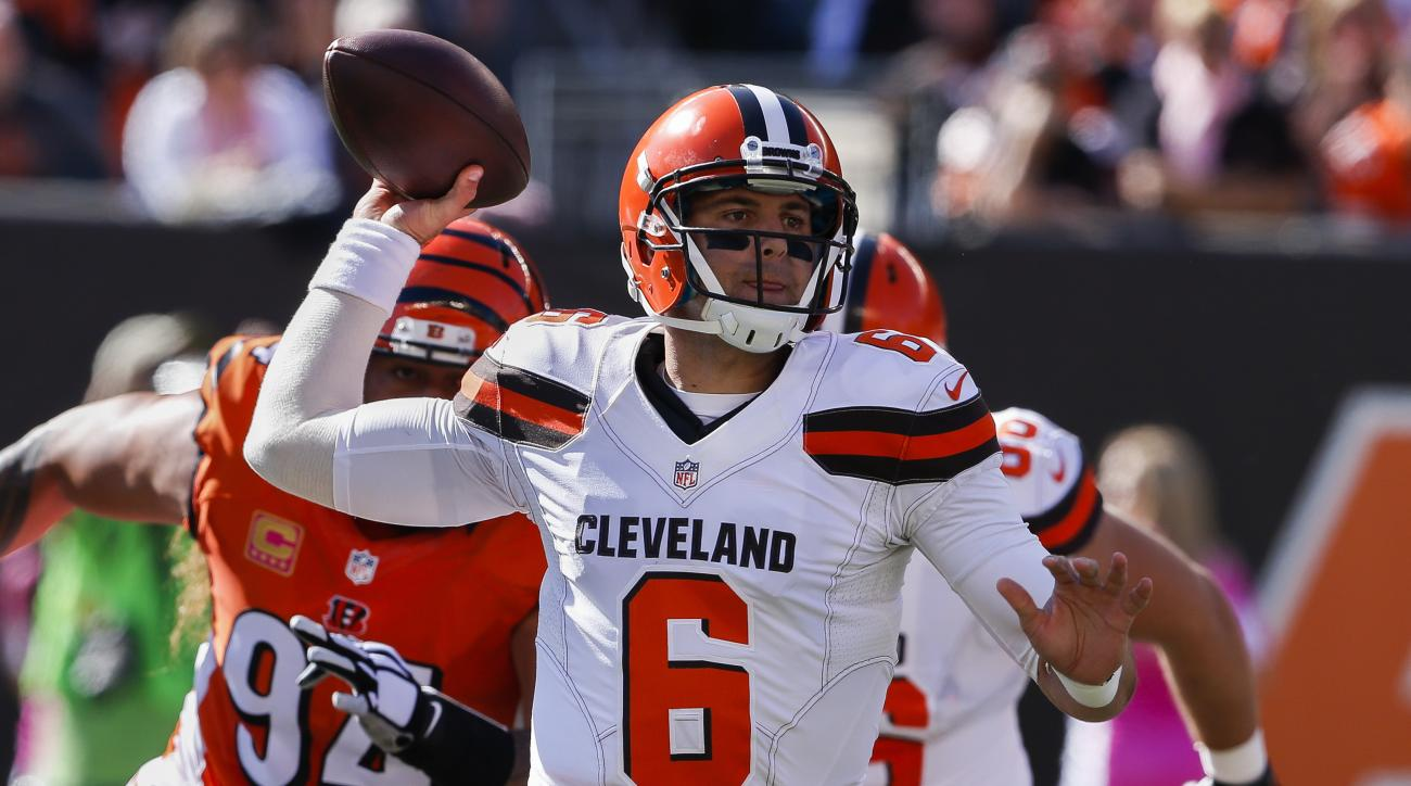 FILE - In this Oct. 23, 2016, file photo, Cleveland Browns quarterback Cody Kessler throws under pressure in the first half of an NFL football game against the Cincinnati Bengals in Cincinnati. Kessler missed a Oct. 30, 2016, 31-28 loss to the New York Je