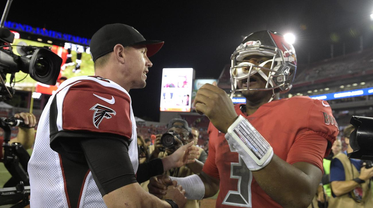 Atlanta Falcons quarterback Matt Ryan (2) shakes hands with Tampa Bay Buccaneers quarterback Jameis Winston (3) after the Falcons defatted the Buccaneers 43-28 during an NFL football game Thursday, Nov. 3, 2016, in Tampa, Fla. (AP Photo/Phelan M. Ebenhack