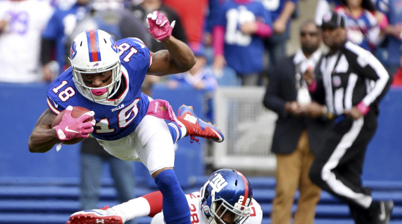 FILE - In this Oct. 4, 2015, file photo, Buffalo Bills wide receiver Percy Harvin (18) is tripped up by New York Giants cornerback Jayron Hosley (28) while returning the opening kickoff in the first half of an NFL football game in Orchard Park, N.Y. Bills