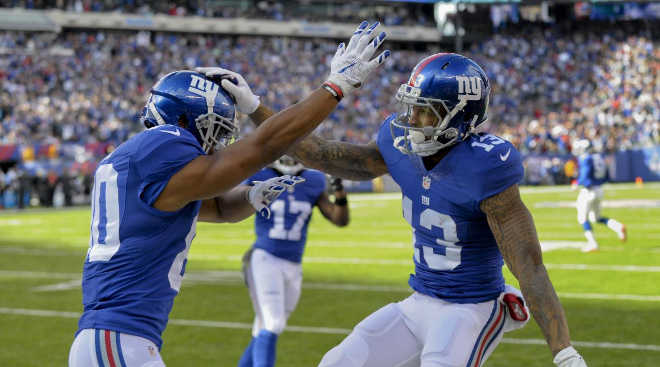 New York Giants wide receiver Odell Beckham (13) celebrates with wide receiver Victor Cruz (80) after scoring a touchdown against the Philadelphia Eagles during the first quarter of an NFL football game, Sunday, Nov. 6, 2016, in East Rutherford, N.J. (AP