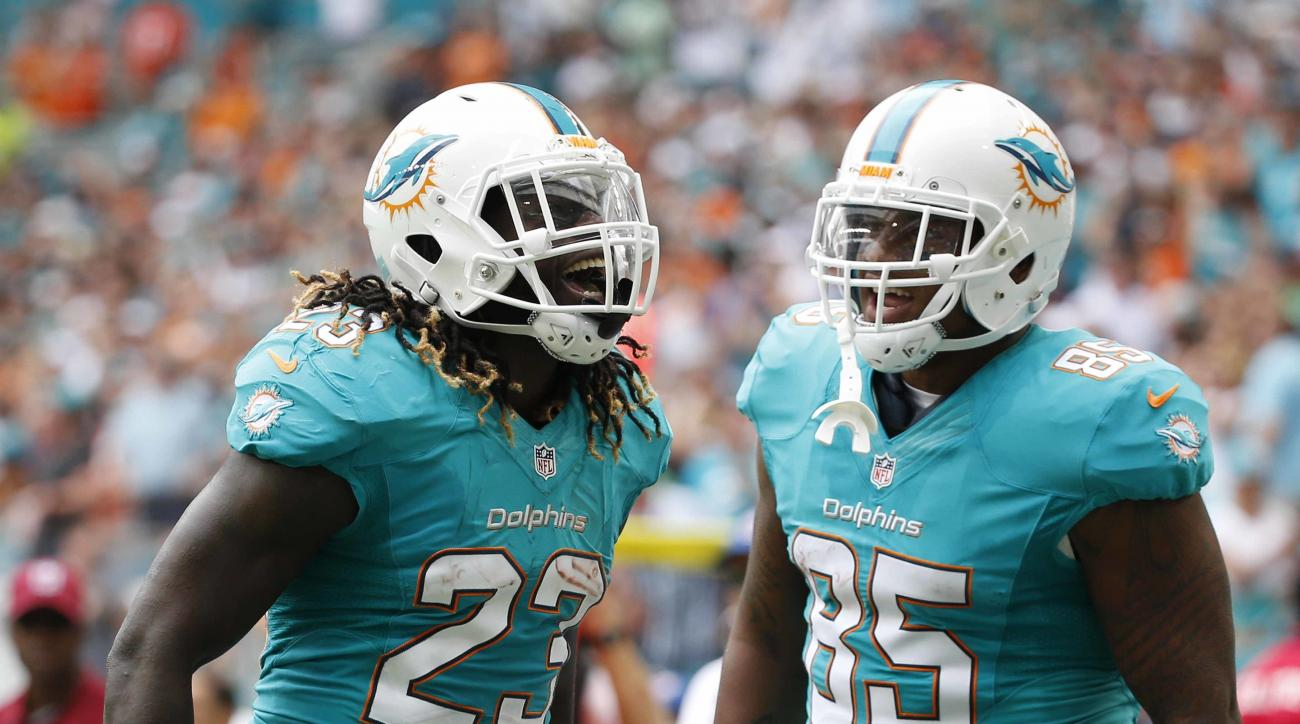 Miami Dolphins running back Jay Ajayi (23) celebrates his touchdown with tight end Dominique Jones (85), during the first half of an NFL football game against the New York Jets, Sunday, Nov. 6, 2016, in Miami Gardens, Fla. (AP Photo/Wilfredo Lee)