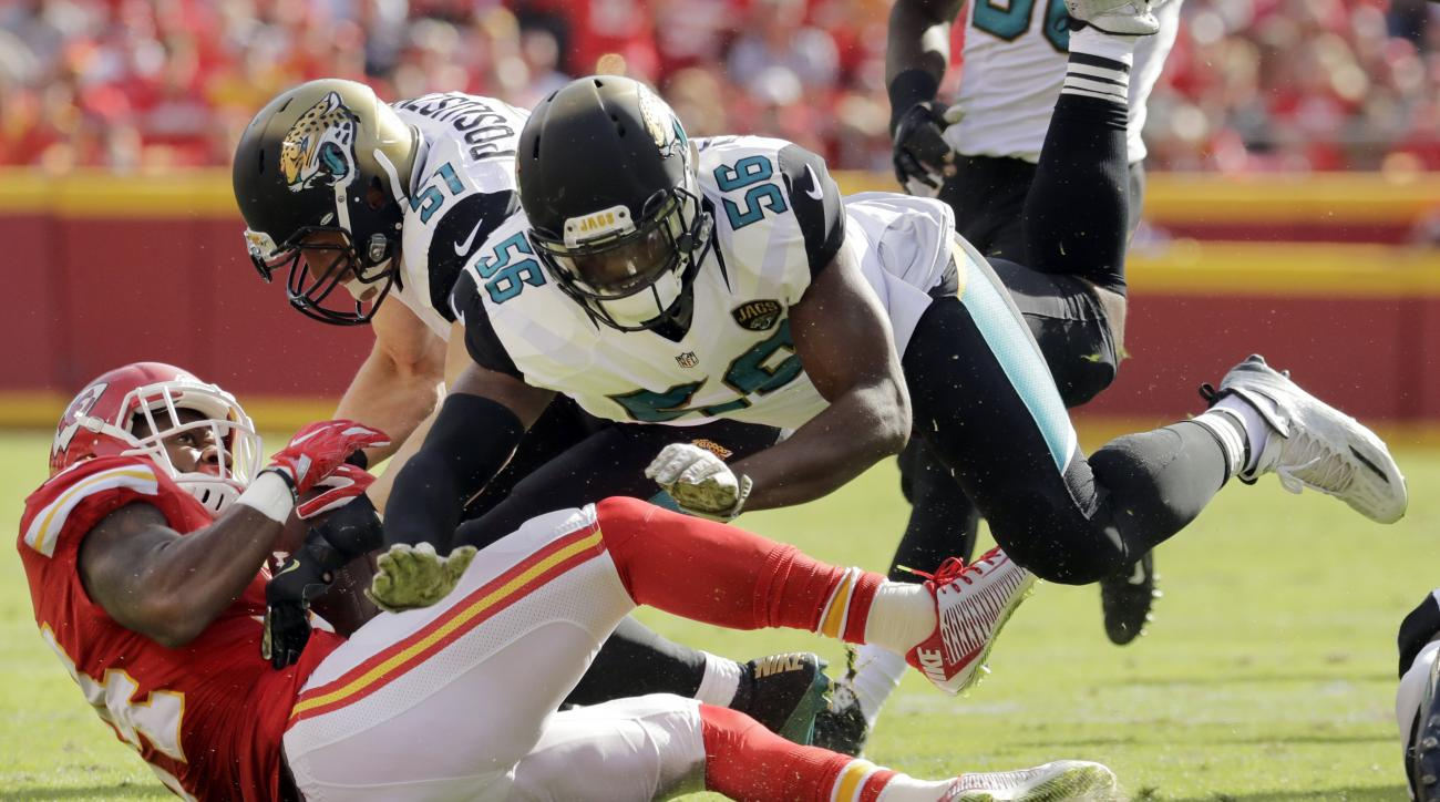 Kansas City Chiefs running back Knile Davis (34) is tackled by Jacksonville Jaguars defensive end Dante Fowler (56) and linebacker Paul Posluszny (51) during the first half of an NFL football game in Kansas City, Mo., Sunday, Nov. 6, 2016. (AP Photo/Charl