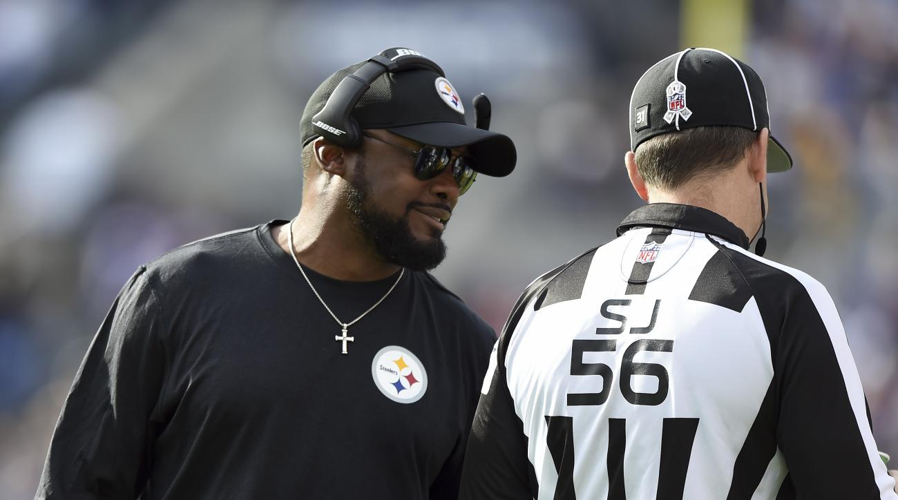 Pittsburgh Steelers head coach Mike Tomlin, left, speaks with side judge Allen Baynes in the first half of an NFL football game against the Baltimore Ravens, Sunday, Nov. 6, 2016, in Baltimore. (AP Photo/Gail Burton)