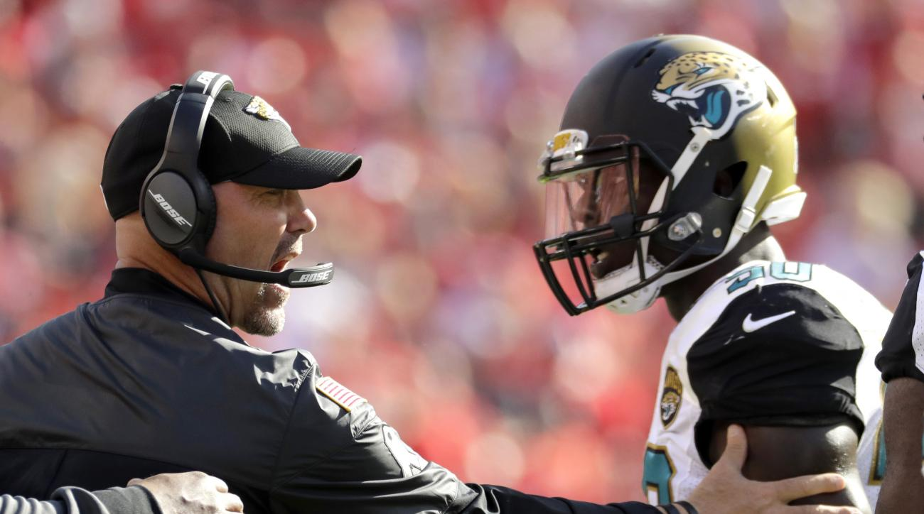 Jacksonville Jaguars head coach Gus Bradley, left, addresses linebacker Telvin Smith, right, during the first half of an NFL football game against the Kansas City Chiefs in Kansas City, Mo., Sunday, Nov. 6, 2016. (AP Photo/Charlie Riedel)