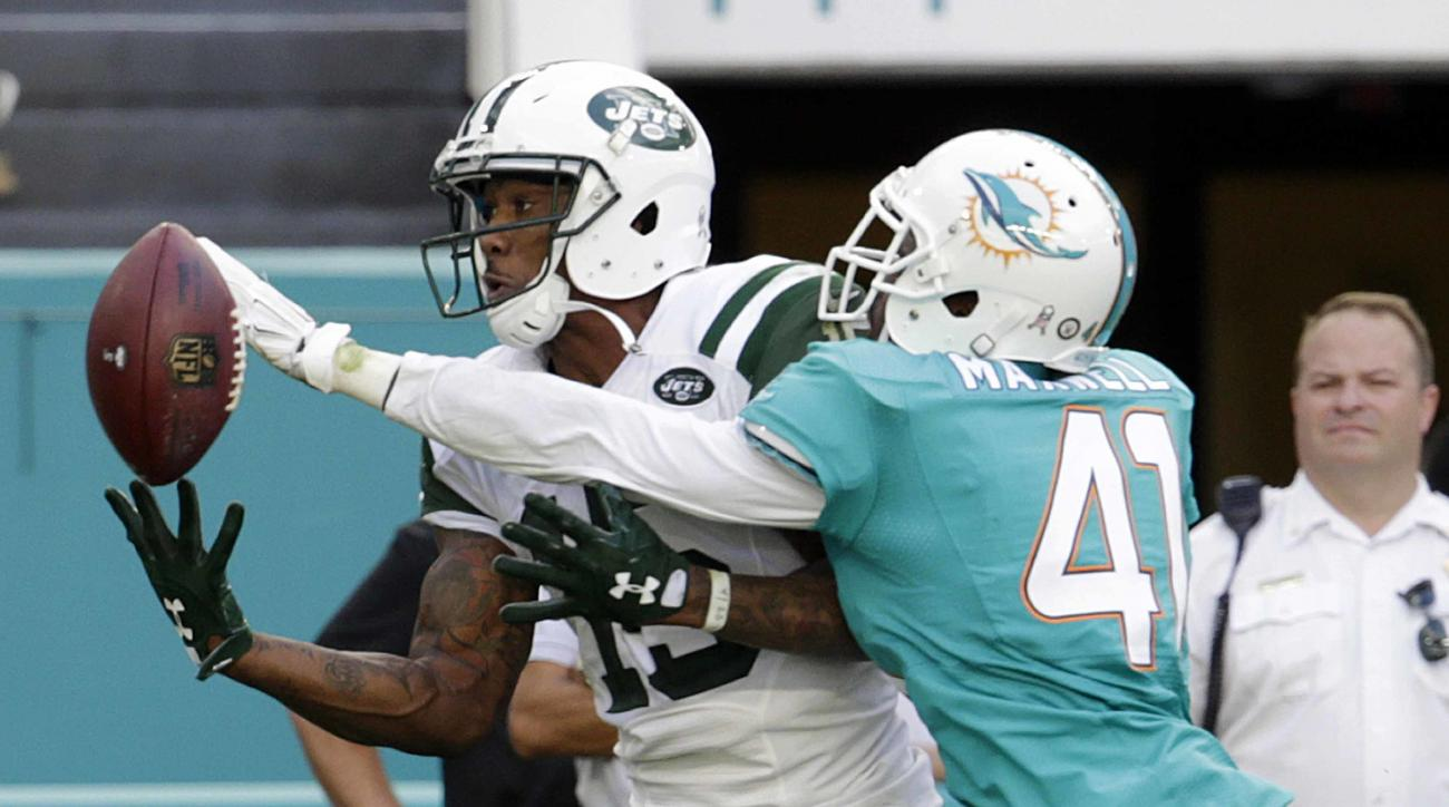 Miami Dolphins cornerback Byron Maxwell (41) attempts to block a pass intended for New York Jets wide receiver Brandon Marshall (15), during the second half of an NFL football game, Sunday, Nov. 6, 2016, in Miami Gardens, Fla. (AP Photo/Lynne Sladky)