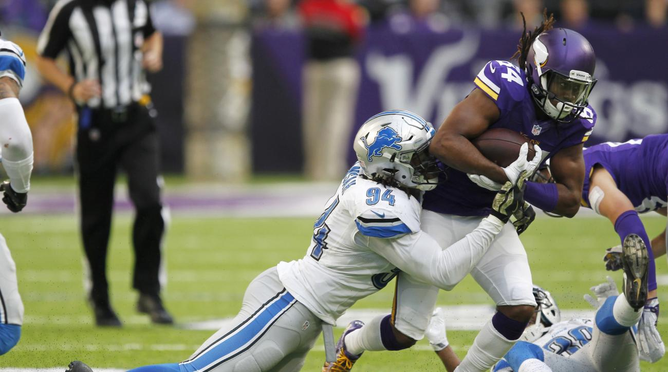 Minnesota Vikings wide receiver Cordarrelle Patterson (84) is tackled by Detroit Lions defensive end Ezekiel Ansah (94) during the second half of an NFL football game Sunday, Nov. 6, 2016, in Minneapolis. (AP Photo/Andy Clayton-King)