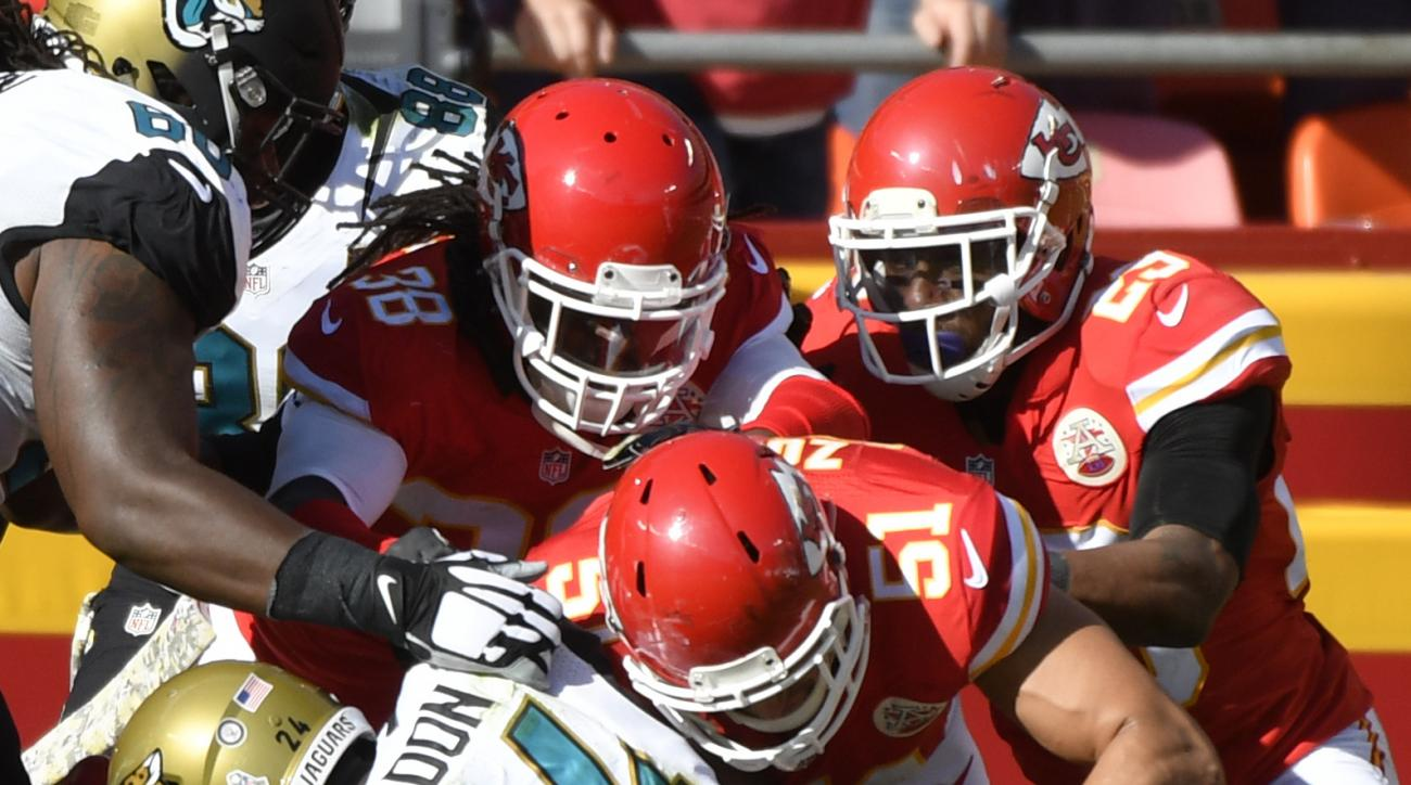 Kansas City Chiefs defensive back Eric Berry (29), linebacker Frank Zombo (51) and defensive back Ron Parker (38) prevent Jacksonville Jaguars running back T.J. Yeldon (24) from crossing into the end zone, during the first half of an NFL football game in