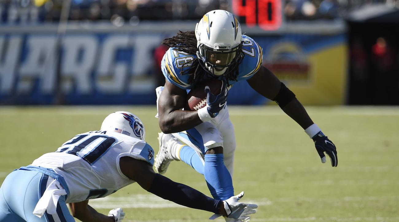 San Diego Chargers running back Melvin Gordon (28) runs with the ball as Tennessee Titans cornerback Perrish Cox defends during the first half of an NFL football game, Sunday, Nov. 6, 2016, in San Diego. (AP Photo/Denis Poroy)