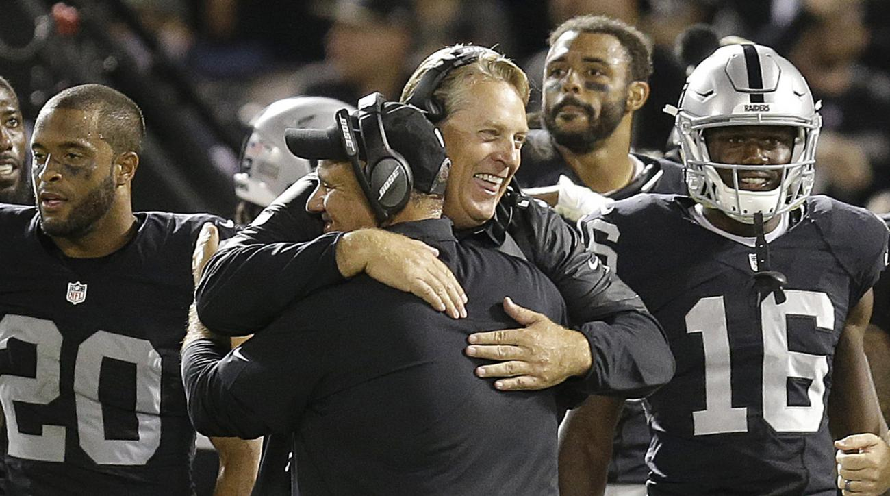 Oakland Raiders head coach Jack Del Rio, facing, hugs an assistant coach during the second half of an NFL football game against the Denver Broncos in Oakland, Calif., Sunday, Nov. 6, 2016. (AP Photo/Ben Margot)