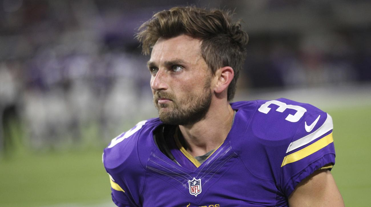 FILE - In this Oct. 3, 2016, file photo, Minnesota Vikings kicker Blair Walsh walks on the sidelines during the first half of an NFL football game against the New York Giants, in Minneapolis. Walsh has not bounced back from the devastating 27-yard miss th