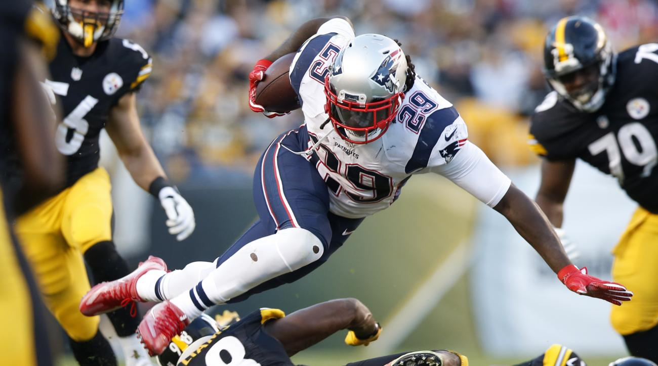 FILE - In this Oct. 23, 2016, file photo, New England Patriots running back LeGarrette Blount (29) is upended by Pittsburgh Steelers inside linebacker Vince Williams (98) during the first half of an NFL football game in Pittsburgh. Blount's production ove