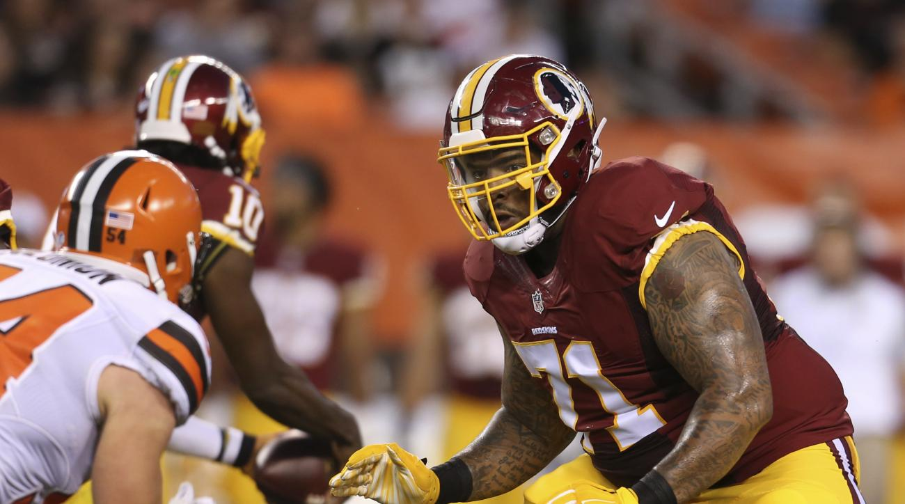 In this photo taken Aug. 13, 2015, Washington Redskins tackle Trent Williams (71) against the Cleveland Browns linebacker Scott Solomon (54) during an NFL preseason football game in Cleveland. Williams four-game absence is a substantial blow to the Washin
