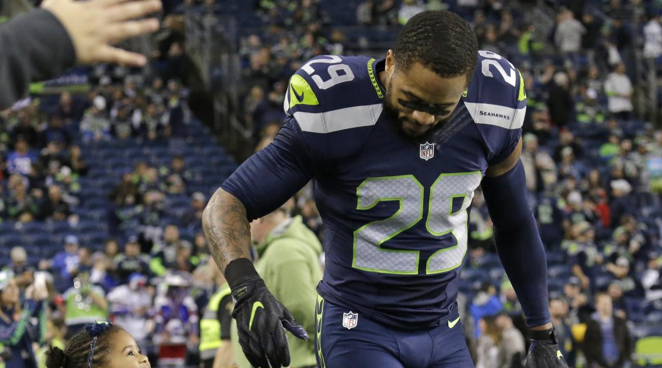 Seattle Seahawks free safety Earl Thomas, right, is greeted by his daughter, Kaleigh, during warmups before an NFL football game against the Buffalo Bills, Monday, Nov. 7, 2016, in Seattle. (AP Photo/John Froschauer)