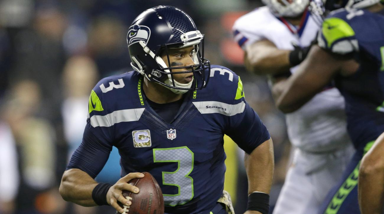 Seattle Seahawks quarterback Russell Wilson looks to pass against the Buffalo Bills in the first half of an NFL football game, Monday, Nov. 7, 2016, in Seattle. (AP Photo/John Froschauer)