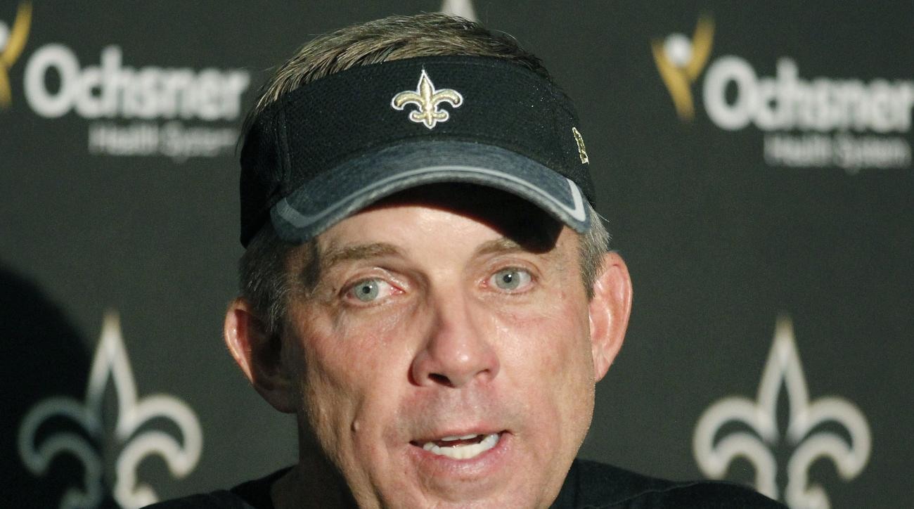 FILE - In this Aug. 11, 2016, file photo, New Orleans Saints head coach Sean Payton speaks to the media after a preseason NFL football game against the New England Patriots, in Foxborough, Mass. Payton says a handful of roster moves this week, including t