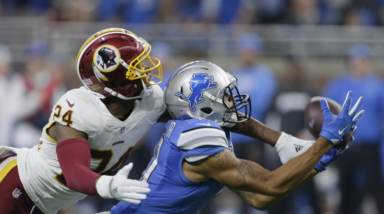 FILE - In this Oct. 23, 2016 file photo, Washington Redskins cornerback Josh Norman (24) covers Detroit Lions wide receiver Marvin Jones during the second half of an NFL football game in Detroit. To no one's surprise, Norman is sticking to his style, on a
