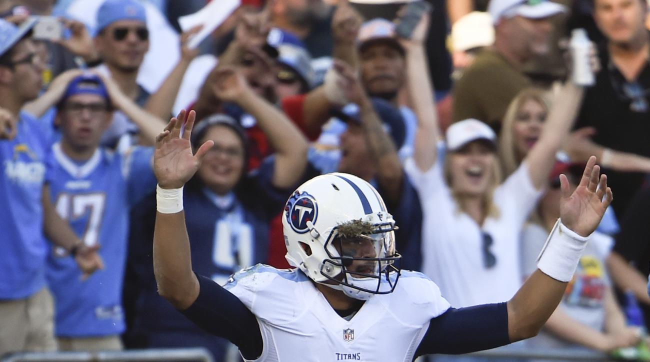 FILE - In this Nov. 6, 2016, file photo, Tennessee Titans quarterback Marcus Mariota reacts after scoring a touchdown during the second half of an NFL football game against the San Diego Chargers, in San Diego. Mariota has helped the Titans (4-5) win more