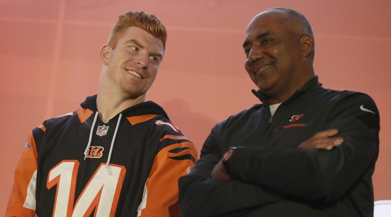 FILe - In this Oct. 29, 2016, file photo, Cincinnati Bengals quarterback Andy Dalton, left, smiles on stage with head coach Marvin Lewis during an NFL Fan Rally at the NFL House in Victoria House, in London. A poor start left the Bengals lagging far behin