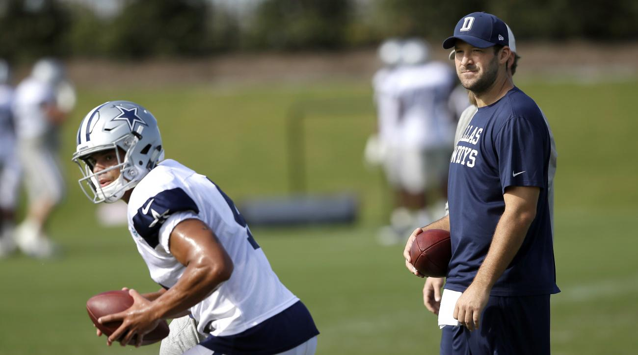 FILE - In this Oct. 26, 2016, file photo, Dallas Cowboys quarterback Tony Romo looks on as fellow quarterback Dak Prescott runs a drill during football practice at the team's practice facility in Frisco, Texas. Romo is running the scout team in practice e