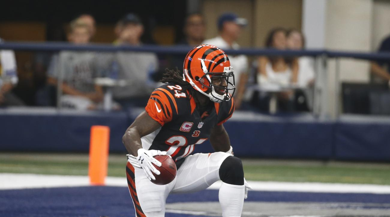 FILE - In this Oct. 9, 2016, file photo, Cincinnati Bengals cornerback Adam Jones kneels after securing a kick off from the Dallas Cowboys during an NFL football game in Arlington. The NFL is halfway through its one-season experiment with a rule placing t