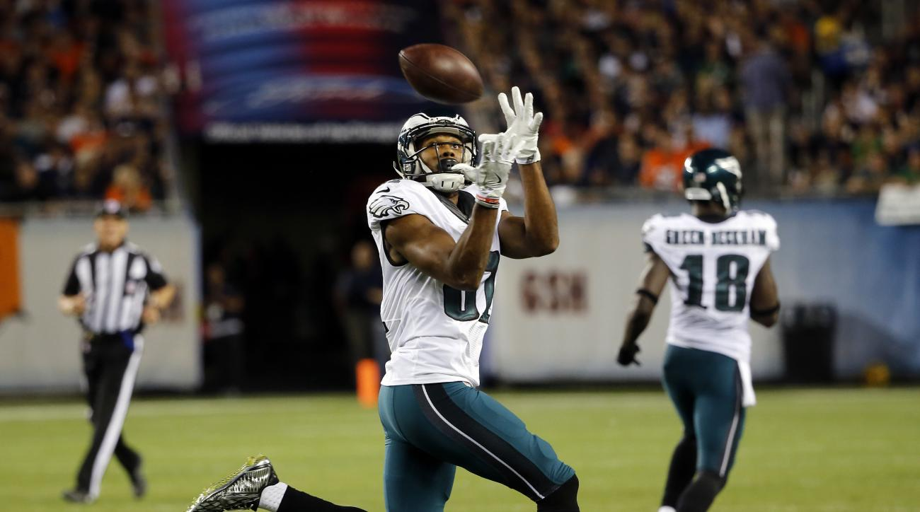 FILE - In this Sept. 19, 2016, file photo, Philadelphia Eagles wide receiver Jordan Matthews (81) receives a pass from Philadelphia Eagles quarterback Carson Wentz (11) during the first half of an NFL football game against the Chicago Bears in Chicago. Ma