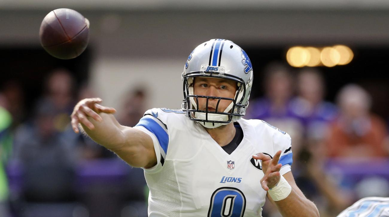 FILE - In this Nov. 6, 2016, file photo, Detroit Lions quarterback Matthew Stafford throws a pass during the first half of an NFL football game against the Minnesota Vikings in Minneapolis. In his first season without Calvin Johnson to throw to, Stafford
