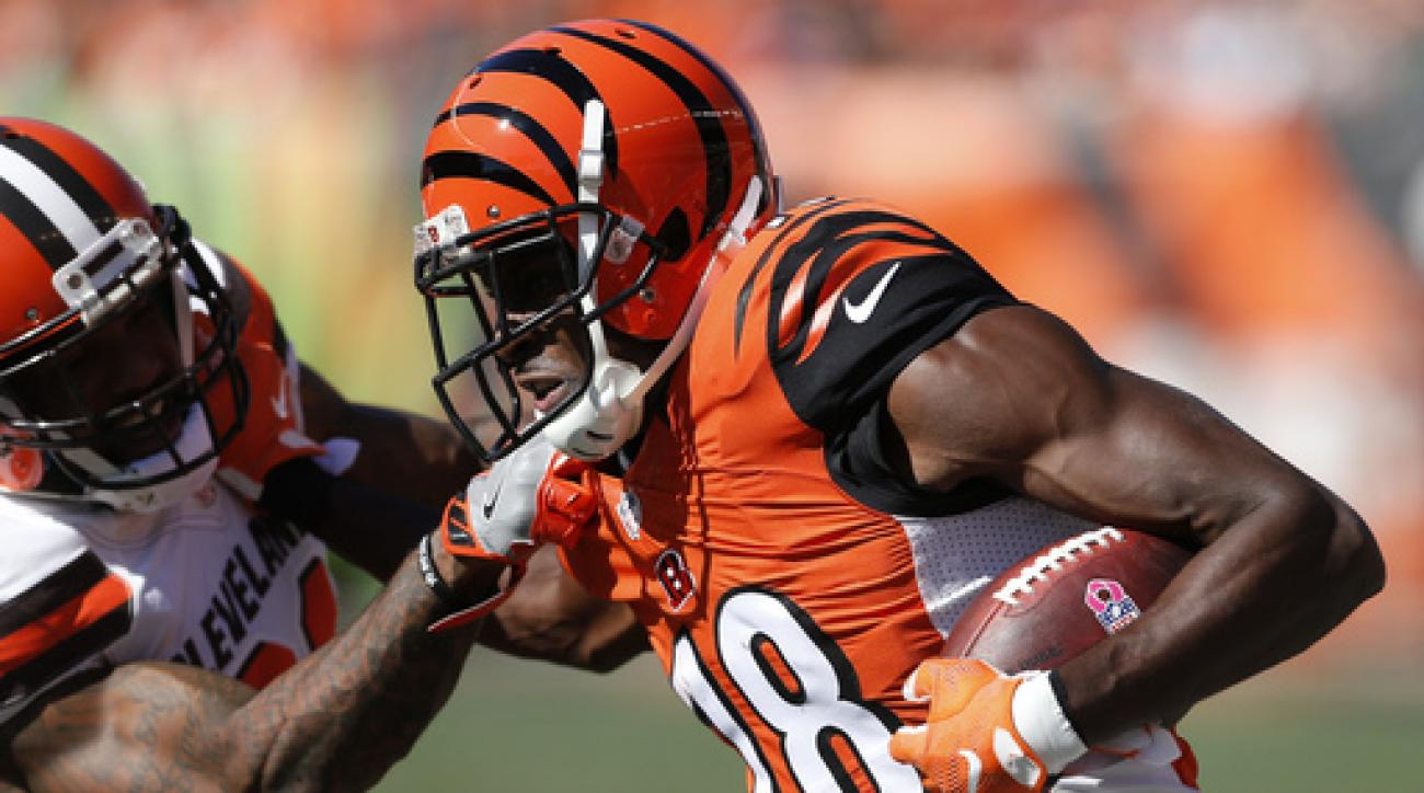 FILE - In this Oct. 23, 2016, file photo, Cincinnati Bengals wide receiver A.J. Green (18) runs against Cleveland Browns cornerback Jamar Taylor, left, in the first half of an NFL football game in Cincinnati. Green leads the NFL with 59 catches and is sec