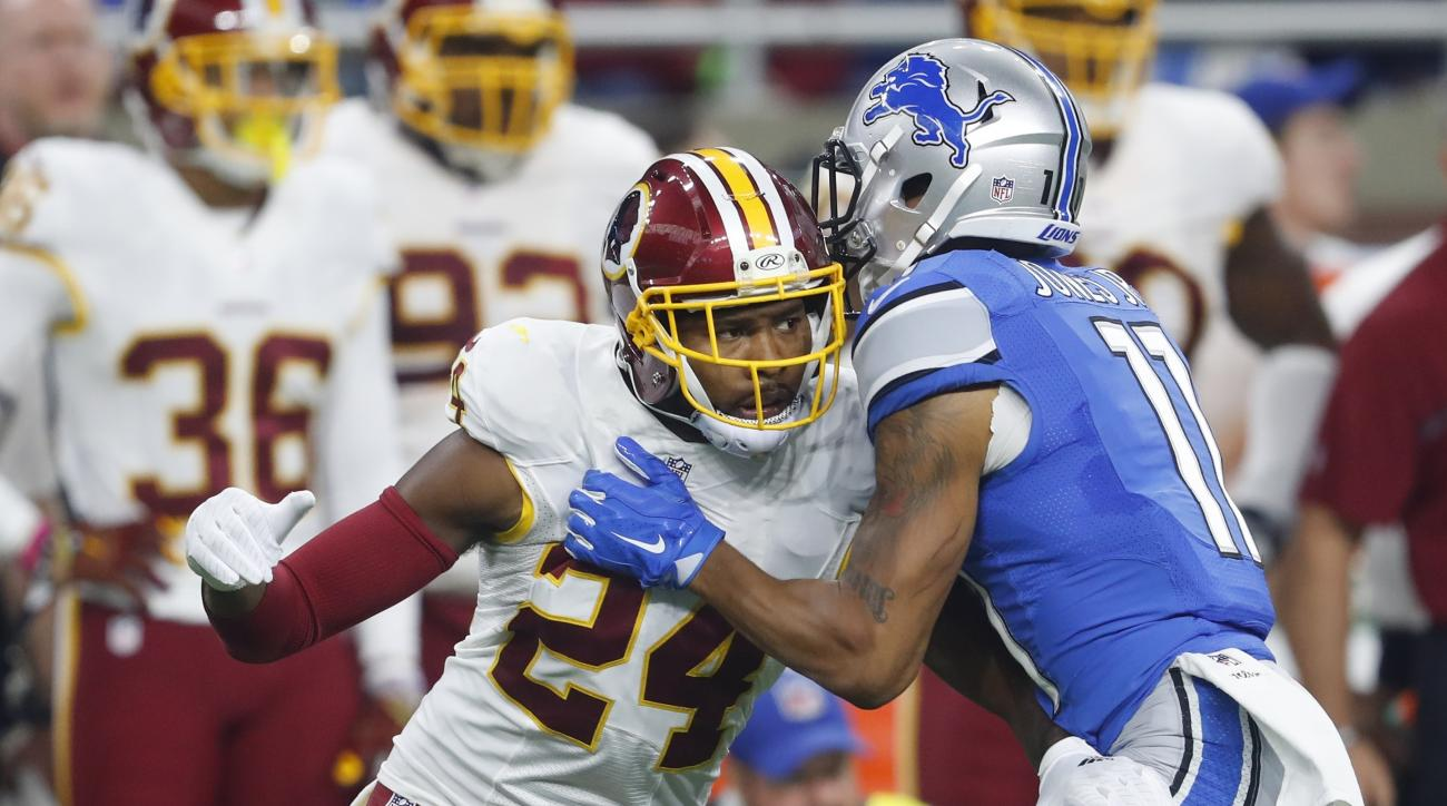 In this photo taken Oct. 23, 2016, Washington Redskins cornerback Josh Norman (24) and Detroit Lions wide receiver Marvin Jones (11) push each other during the first half of an NFL football game in Detroit. Leave it to Norman to speak his mind. Asked how