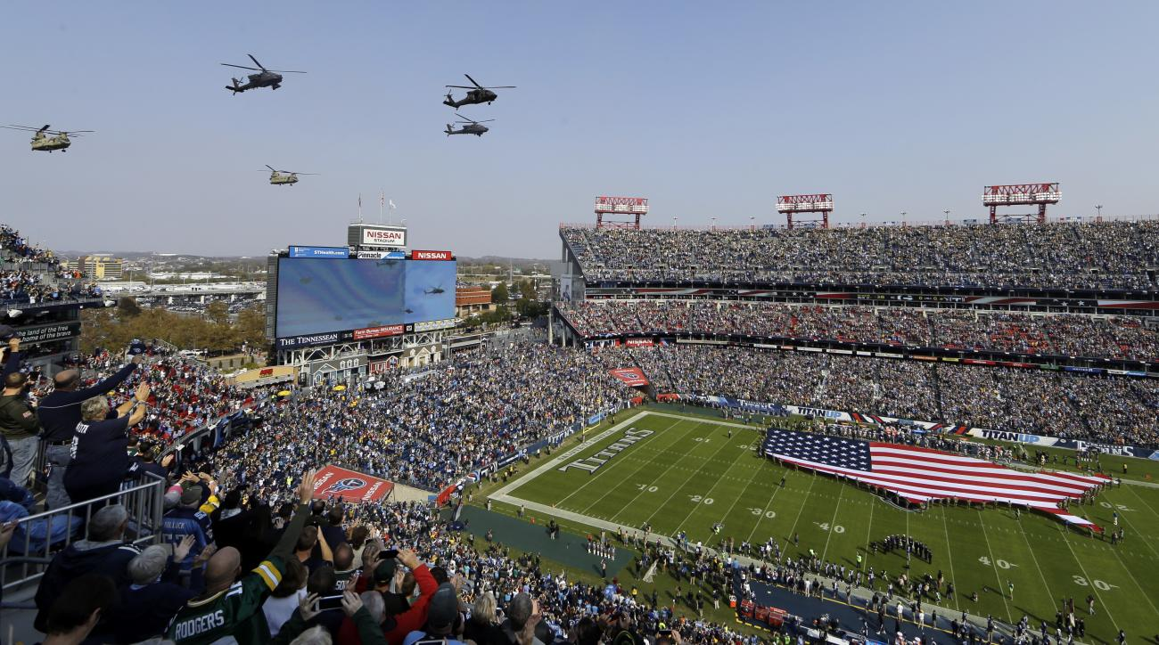 Helicopters fly over Nissan Stadium during the Salute to Service pregame activities before an NFL football game between the Tennessee Titans and the Green Bay Packers Sunday, Nov. 13, 2016, in Nashville, Tenn. (AP Photo/James Kenney)
