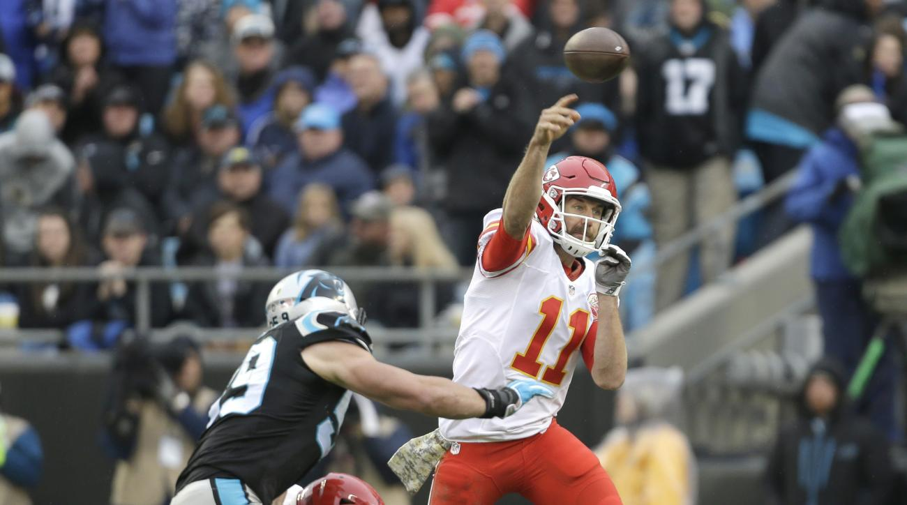 Kansas City Chiefs' Alex Smith (11) throws a pass as Carolina Panthers' Luke Kuechly (59) closes in during the first half of an NFL football game in Charlotte, N.C., Sunday, Nov. 13, 2016. (AP Photo/Bob Leverone)