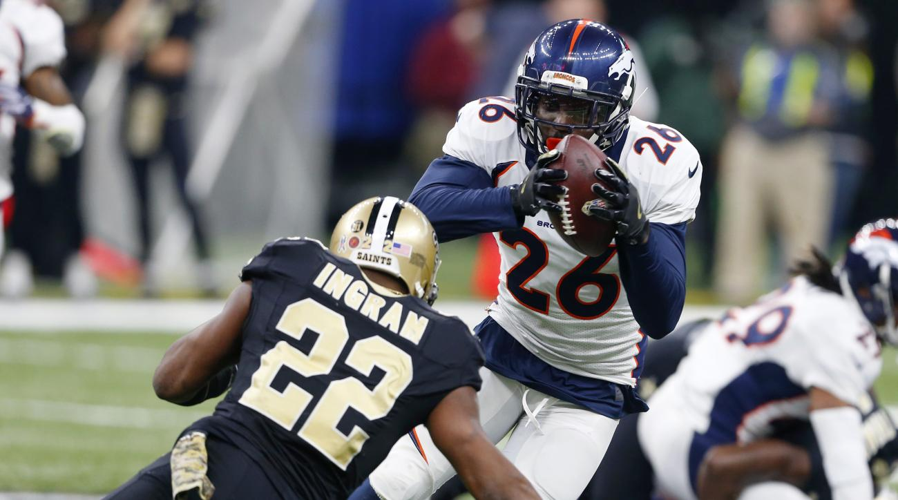 Denver Broncos free safety Darian Stewart (26) tries to return an interception past New Orleans Saints running back Mark Ingram (22) in the first half of an NFL football game in New Orleans, Sunday, Nov. 13, 2016. (AP Photo/Butch Dill)