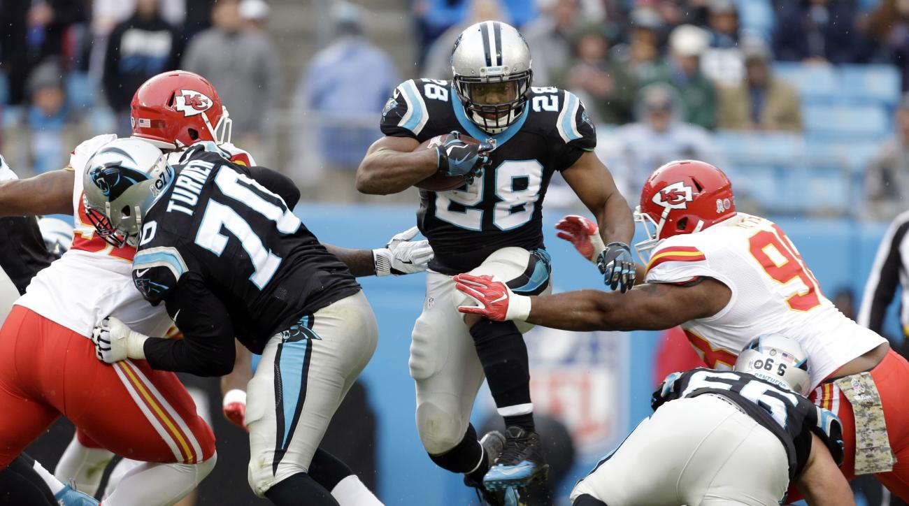 Carolina Panthers' Jonathan Stewart (28) leaps over players as he runs against the Kansas City Chiefs in the first half of an NFL football game in Charlotte, N.C., Sunday, Nov. 13, 2016. (AP Photo/Bob Leverone)