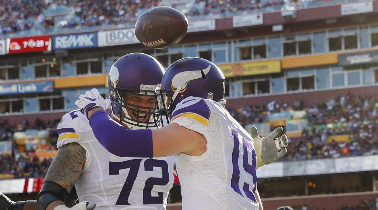 Minnesota Vikings wide receiver Adam Thielen (19) celebrates his touchdown with offensive tackle Jake Long (72) during the first half of an NFL football game against the Washington Redskins in Landover, Md., Sunday, Nov. 13, 2016. (AP Photo/Alex Brandon)