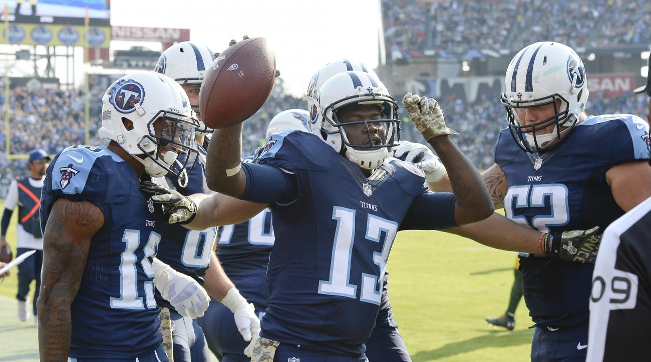 Tennessee Titans wide receiver Kendall Wright (13) celebrates after scoring a touchdown on a 6-yard pass reception against the Green Bay Packers in the first half of an NFL football game Sunday, Nov. 13, 2016, in Nashville, Tenn. (AP Photo/Mark Zaleski)