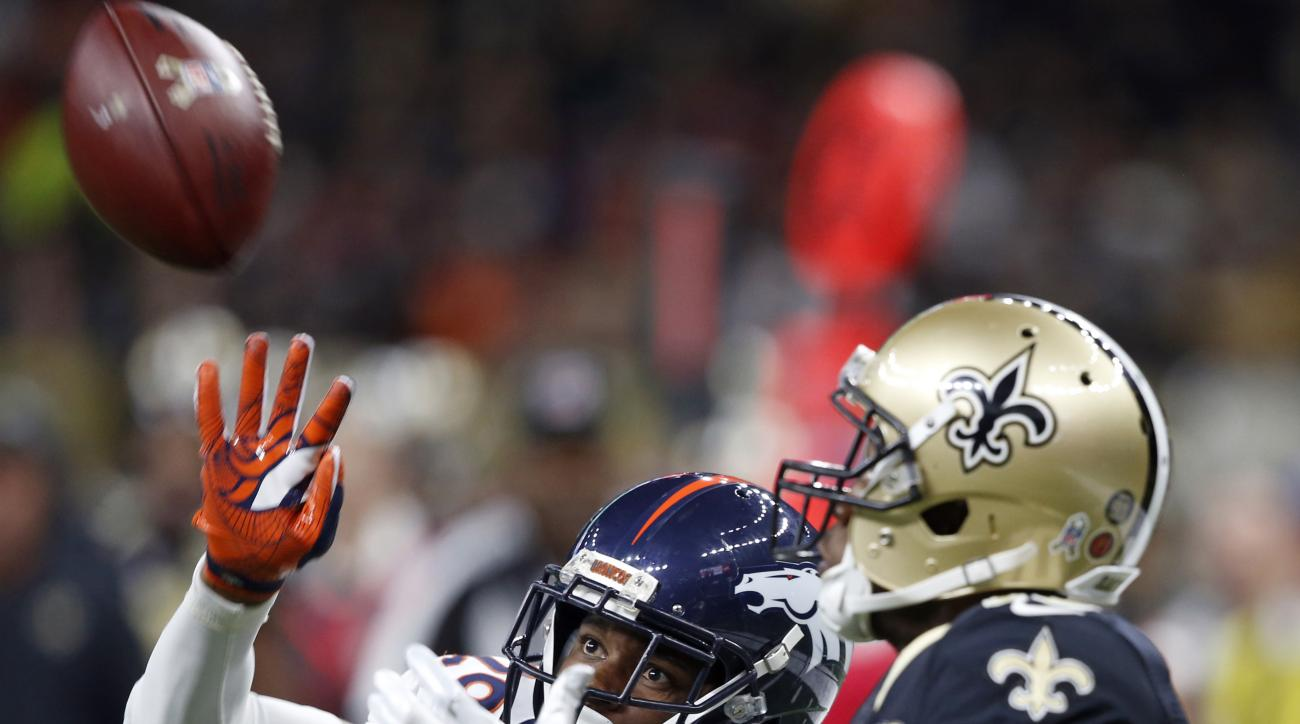 New Orleans Saints wide receiver Brandin Cooks (10) pulls in a 37 yard pass play to set up a touchdown as Denver Broncos cornerback Bradley Roby (29) covers in the second half of an NFL football game in New Orleans, Sunday, Nov. 13, 2016. (AP Photo/John M
