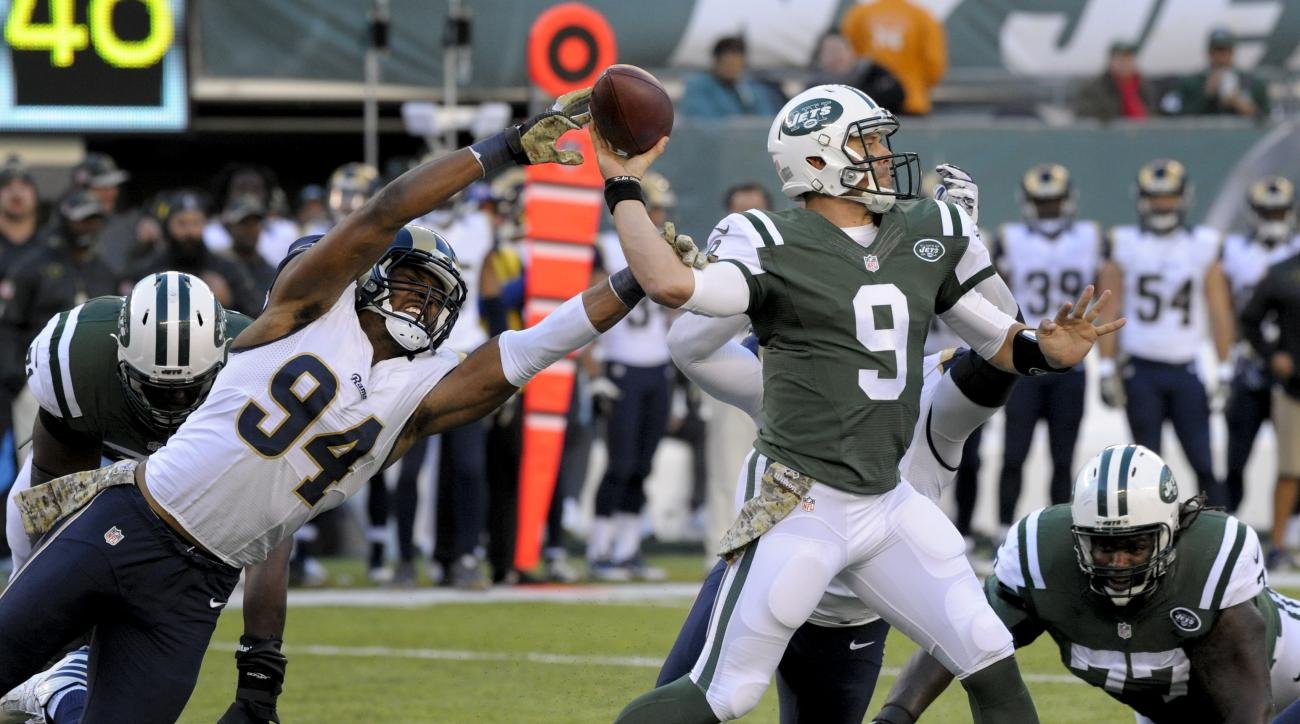 New York Jets quarterback Bryce Petty (9) throws under pressure from Los Angeles Rams defensive end Robert Quinn (94) during the third quarter of an NFL football game, Sunday, Nov. 13, 2016, in East Rutherford, N.J. (AP Photo/Bill Kostroun)