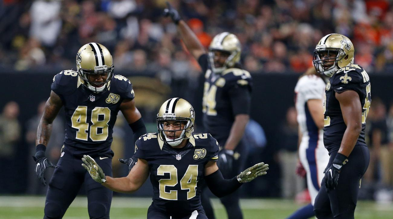 New Orleans Saints cornerback Sterling Moore (24) reacts after intercepting a pass in the first half of an NFL football game against the Denver Broncos in New Orleans, Sunday, Nov. 13, 2016. (AP Photo/Butch Dill)