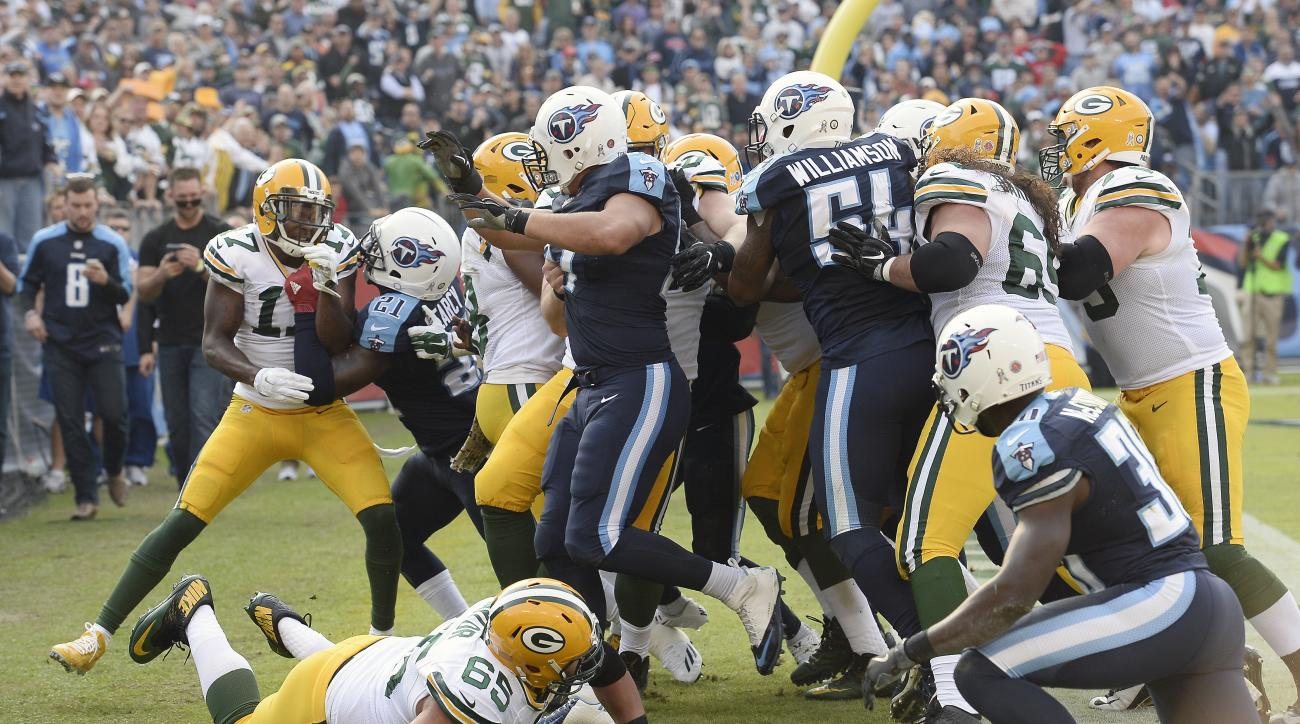 Green Bay Packers and Tennessee Titans players scuffle after Green Bay Packers quarterback Aaron Rodgers was hit after scoring a touchdown in the second half of an NFL football game Sunday, Nov. 13, 2016, in Nashville, Tenn. (AP Photo/Mark Zaleski)