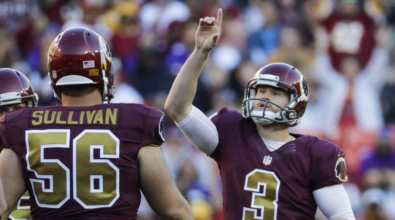 Washington Redskins place kicker Dustin Hopkins (3) points skyward after scoring a field goal during the second half of an NFL football game against the Minnesota Vikings in Landover, Md., Sunday, Nov. 13, 2016. (AP Photo/Patrick Semansky)