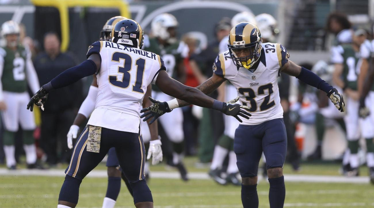 Los Angeles Rams free safety Maurice Alexander (31) and cornerback Troy Hill (32) celebrate after a defensive play against the New York Jets during the fourth quarter of an NFL football game, Sunday, Nov. 13, 2016, in East Rutherford, N.J. (AP Photo/Seth