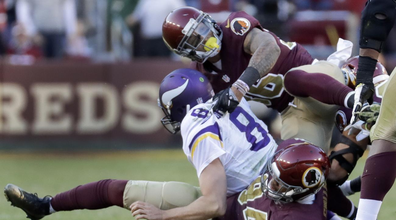 Minnesota Vikings quarterback Sam Bradford (8) is sacked by Washington Redskins linebacker Preston Smith (94) and safety Su'a Cravens (36) during the second half of an NFL football game in Landover, Md., Sunday, Nov. 13, 2016. Washington defeated Minnesot