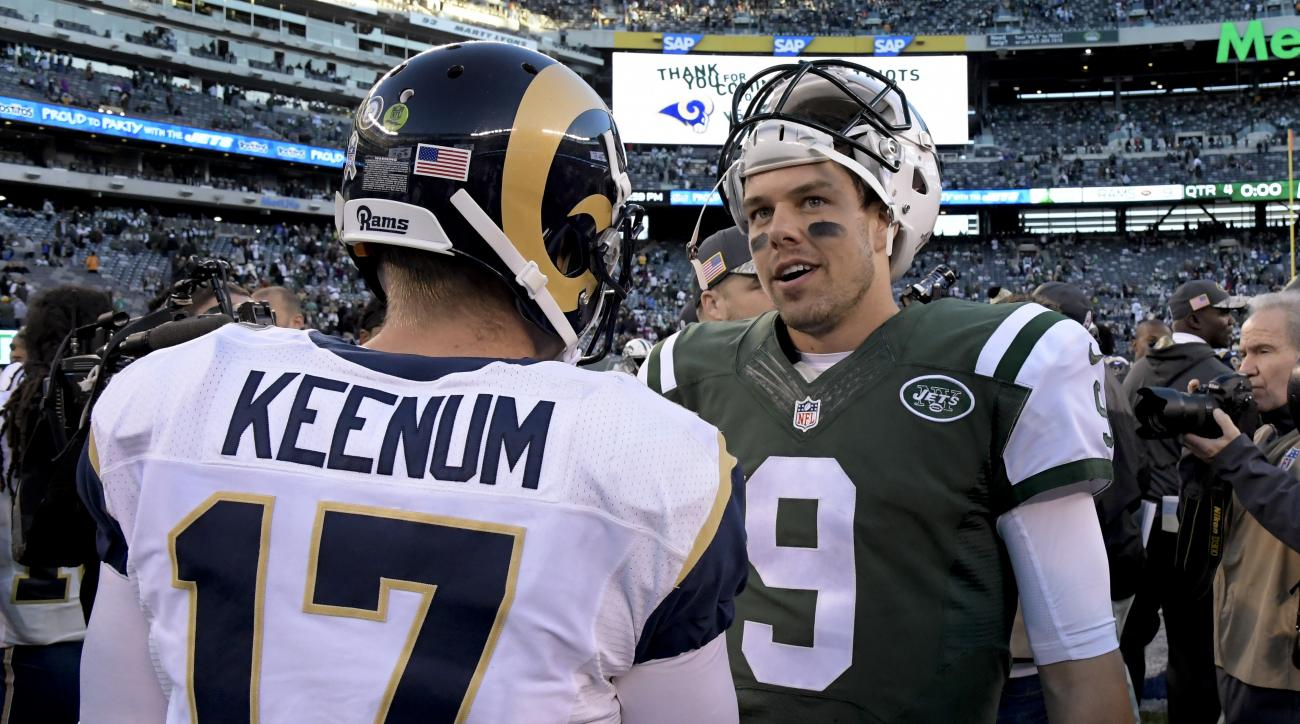 New York Jets quarterback Bryce Petty (9) talks with Los Angeles Rams quarterback Case Keenum (17) after plain the Rams in an NFL football game, Sunday, Nov. 13, 2016, in East Rutherford, N.J. The Rams won 9-6. (AP Photo/Bill Kostroun)
