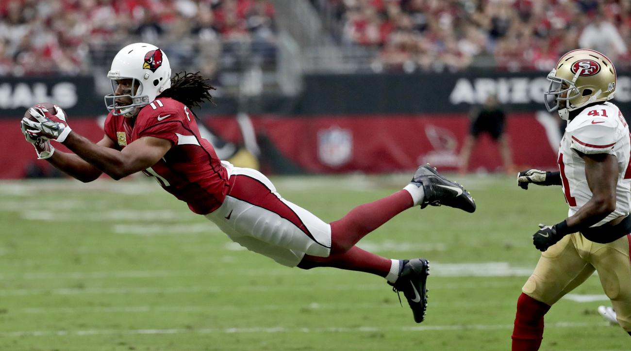 Arizona Cardinals wide receiver Larry Fitzgerald (11) makes a diving catch as San Francisco 49ers strong safety Antoine Bethea (41) defends during the first half of an NFL football game, Sunday, Nov. 13, 2016, in Glendale, Ariz. (AP Photo/Rick Scuteri)