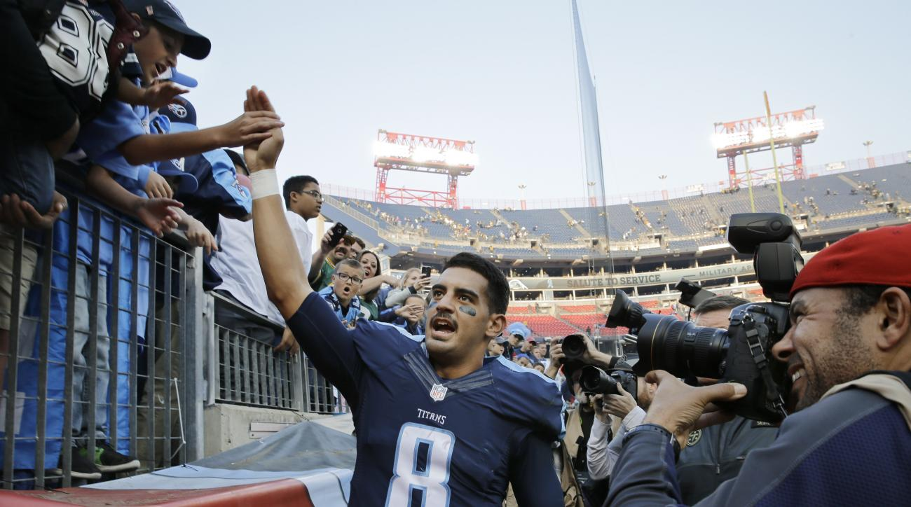Tennessee Titans quarterback Marcus Mariota slaps hands with fans as he leaves the field after the Titans beat the Green Bay Packers 47-25 in an NFL football game Sunday, Nov. 13, 2016, in Nashville, Tenn. (AP Photo/James Kenney)