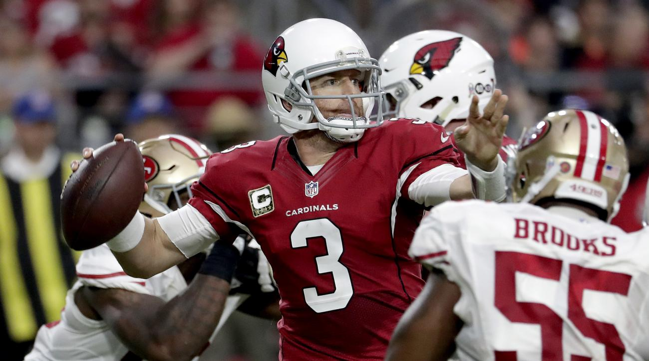 Arizona Cardinals quarterback Carson Palmer (3) throws as San Francisco 49ers outside linebacker Ahmad Brooks (55) pursues during the second half of an NFL football game, Sunday, Nov. 13, 2016, in Glendale, Ariz. (AP Photo/Rick Scuteri)