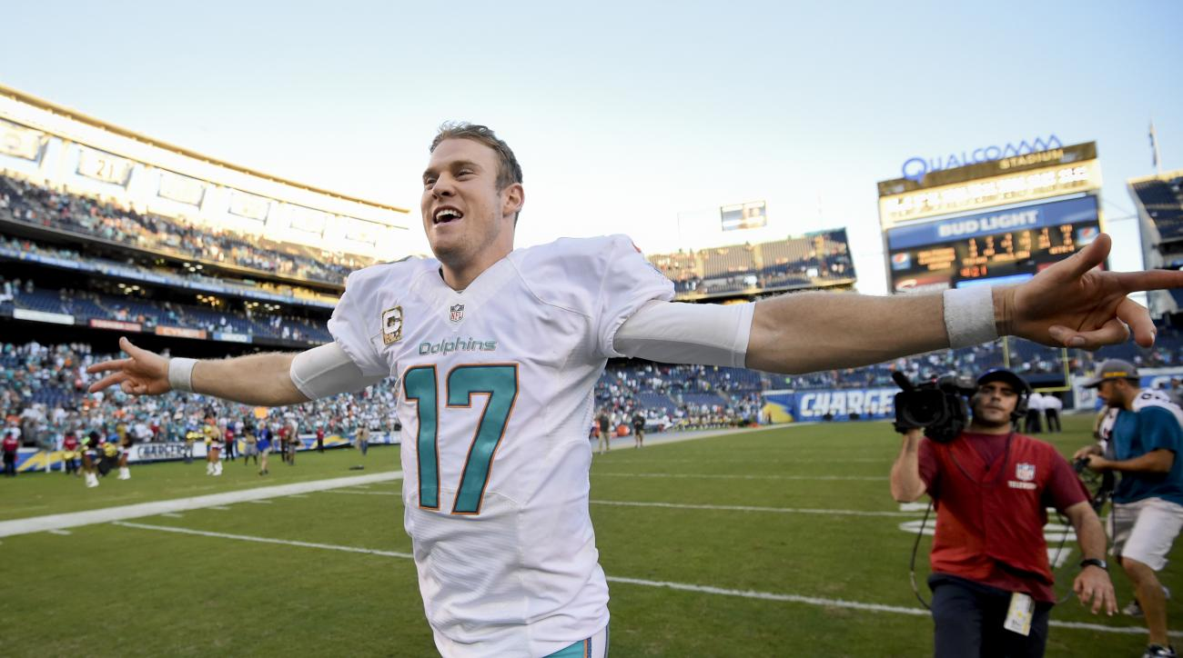 Miami Dolphins quarterback Ryan Tannehill celebrates as his leaves the field after their win against the San Diego Chargers during an NFL football game in San Diego, Sunday, Nov. 13, 2016. (AP Photo/Denis Poroy)