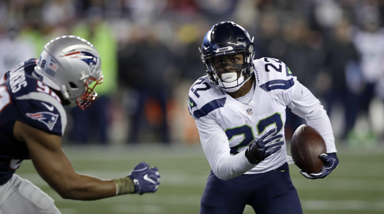 New England Patriots defensive lineman Trey Flowers (98) chases Seattle Seahawks running back C.J. Prosise (22) during the first half of an NFL football game, Sunday, Nov. 13, 2016, in Foxborough, Mass. (AP Photo/Charles Krupa)