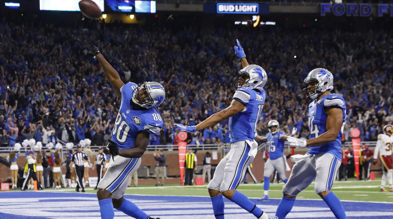 FILE - In this Oct. 23, 2016, file photo, Detroit Lions wide receiver Anquan Boldin (80) throws the ball to fans after his 18-yard touchdown run with seconds remaining in the second half of an NFL football game against the Washington Redskins, in Detroit.